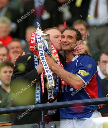 Rangers Manager Alex McLeish kisses Lorenzo Amoruso whilst holding the FA Cup Rangers v Celtic Scottish FA Cup Final Hampden Park Glasgow 4/5/2002 Great Britain Glasgow