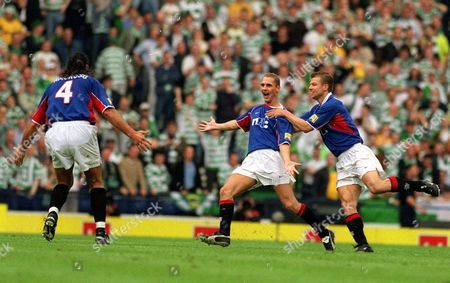 Peter Lovenkrands (centre) celebrates scoring the 1st Rangers goal with Arthur Newman and Lorenzo Amoruso (4) Rangers v Celtic Scottish FA Cup Final Hampden Park Glasgow 4/5/2002 Great Britain Glasgow