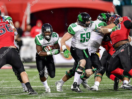 th, .North Texas Mean Green running back Andrew Tucker (25) runs up the middle for a touchdown as North Texas Mean Green offensive lineman Trey Keenan (59) blocks during an NCAA College football game between the North Texas Mean Green Eagles vs Western Kentucky Hilltoppers at Houchens Stadium in Bowling Green, KY