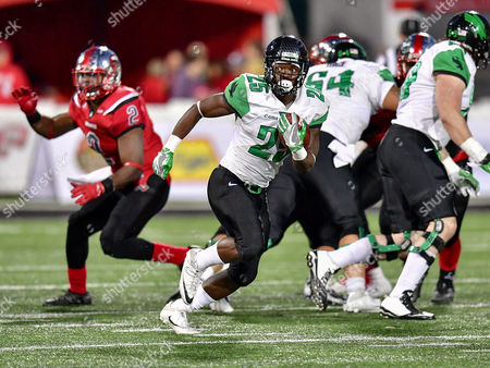 th, .North Texas Mean Green running back Andrew Tucker (25) runs up the middle for a touchdown during an NCAA College football game between the North Texas Mean Green Eagles vs Western Kentucky Hilltoppers at Houchens Stadium in Bowling Green, KY