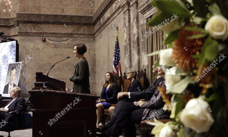 Molly Hill Molly Hill, widow of the late Sen. Andy Hill, speaks to lawmakers gathered for a memorial at the Legislature, in Olympia, Wash. Sen. Hill died of lung cancer on Oct. 31