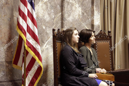 Katie Hill, Molly Hill Katie Hill, left, and Molly Hill, the daughter and widow, respectively, of the late Sen. Andy Hill, listen during a memorial at the Legislature, in Olympia, Wash. Sen. Hill died of lung cancer on Oct. 31