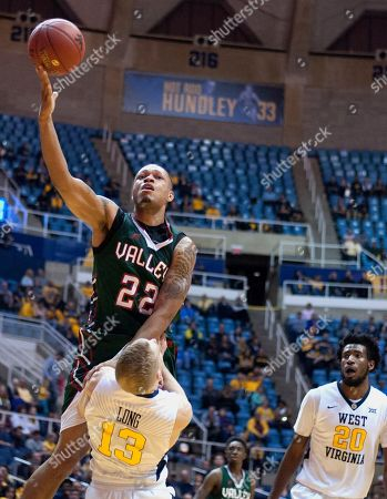 Mississippi Valley State forward Michael Matlock (22) is fouled by West Virginia guard James Long (13) during the first half of an NCAA college basketball game, in Morgantown, W.Va