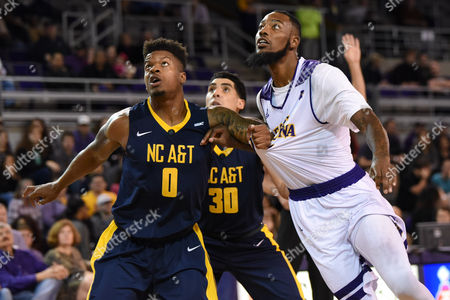 North Carolina A&T Aggies forward Davaris McGowens (0) grabs East Carolina Pirates forward Clarence Williams (23) while positioning for a rebound during the first half of the game between the North Carolina A&T Eagles and the East Carolina University Pirates at Williams Arena at Minges Coliseum, Greenville, NC. East Carolina defeated North Carolina A&T 61-51