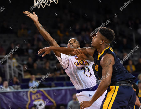 East Carolina Pirates forward Clarence Williams (23) shoots past North Carolina A&T Aggies guard Aaren Edmead (1) drawing the foul during the second half of the game between the North Carolina A&T Eagles and the East Carolina University Pirates at Williams Arena at Minges Coliseum, Greenville, NC. East Carolina defeated North Carolina A&T 61-51