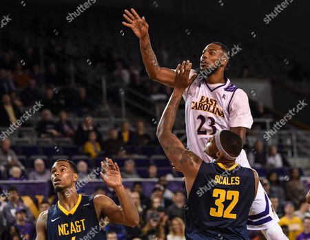 East Carolina Pirates forward Clarence Williams (23) shoots over North Carolina A&T Aggies forward Aaron Scales (32) during the second half of the game between the North Carolina A&T Eagles and the East Carolina University Pirates at Williams Arena at Minges Coliseum, Greenville, NC. East Carolina defeated North Carolina A&T 61-51