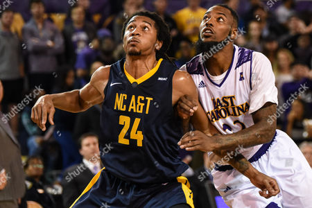 Stock Image of North Carolina A&T Aggies guard Donte Watson (24) and East Carolina Pirates forward Clarence Williams (23) fight for rebound position during the second half of the game between the North Carolina A&T Eagles and the East Carolina University Pirates at Williams Arena at Minges Coliseum, Greenville, NC. East Carolina defeated North Carolina A&T 61-51