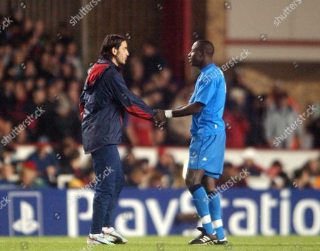 Robert Pires (Arsenal) is welcomed back from injury by Khalilou Fadiga (Auxerre) Arsenal v Auxerre Champions League 22/10/2002 Great Britain London