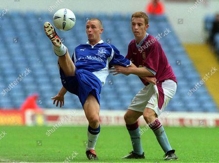 Stock Image of Paul Hopkins (Everton) Andrew Wells (Aston Villa) Aston Villa v Everton FA Youth Cup final 18/5/2002 Great Britain London