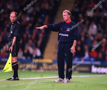 Trevor Francis the Crystal Palace Manager is watched by the Linesman Crystal Palace v Derby County League Division One 17/9/2002 Great Britain London