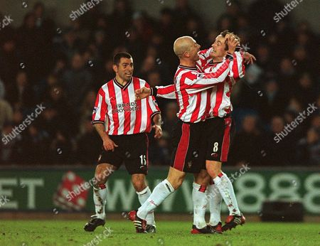 Matt Oakley (8) celebrates scorng the 1st goal for Southampton with Chris Marsden and Francis Benali Millwall v Southampton FA Cup 4th Round Replay 5/02/2003 Great Britain London