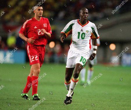 Khalilou Fadiga (Senegal) and Umit Davala (Turkey) Turkey v Senegal The World Cup 1/4 Final Osaka Japan 22/6/02 Japan Osaka