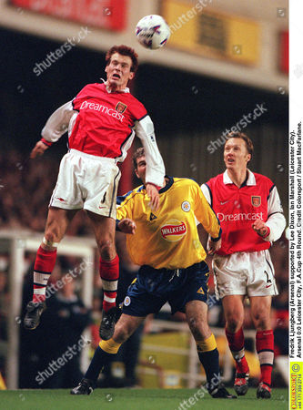 Fredrik Ljungberg (Arsenal) supported by Lee Dixon Ian Marshall (Leicester City) Arsenal 0:0 Leicester City F A Cup 4th Round Great Britain London