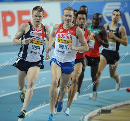 Athletics - World Indoor Championships 2012 - Istanbul James Brewer of Great Britain and Egor Nikolaev of Russia compete in the Men's 1500 Metres first round during day one of the 14th IAAF World Indoor Championships at the Atakoy Athletics Arena Turkey Istanbul