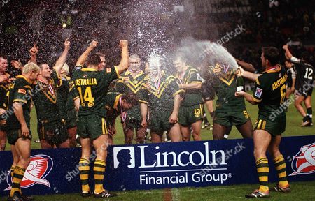 Brad Fittler sprays Champagne over his team mates to celebrate Australia winning the Rugby League World Cup Australia v New Zealand The Rugby League World Cup Final Old Trafford 25/11/00 Great Britain Manchester
