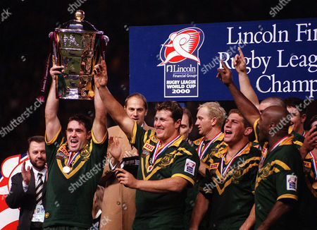 Stock Photo of Brad Fittler lifts the World Cup for Australia Australia v New Zealand The Rugby League World Cup Final Old Trafford 25/11/00 Great Britain Manchester