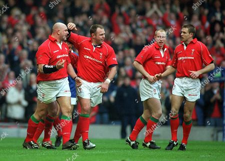 Craig Quinnell celebrates scoring a try for Wales with Scott Quinnell Tom Shanklin and Daffydd James Wales v France The Six Nations Championship The Millennium Stadium Cardiff 16/2/02 Great Britain Cardiff