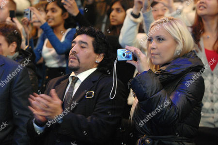 Tennis - Barclays ATP World tour Finals 2010 at the 02 arena London 22/11/2010 Diego Maradona with his girlfriend Veronica Ojeda and her Camera after the match Murray v Federer