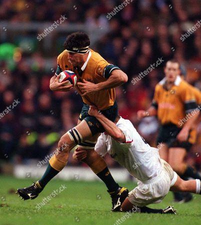 John Eales (Australia) tackled by Neil Back (England) England v Australia Twickenham 18/11/2000 Great Britain London