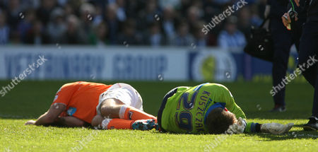 Football - 2012 / 2013 Championship - Brighton and Hove Albion vs Blackpool Both Goalkeeper Brighton's Tomasz Kuszczak and Gary Taylor-Fletcher of Blackpool lay injured after a colliding at The American Express Community Stadium