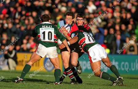 Dan Luger (Harlequins) halted by Freddie Tuilagi and Austin Healey (Leicester) Harlequins v Leicester 22/12/2001 Great Britain London