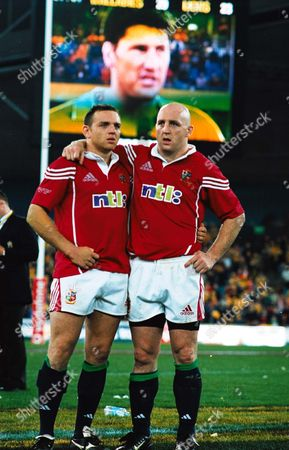 Irish Lions Rob Henderson (left) and Keith Wood after the game with the face of Australian Captain John Eales on the TV Screen Australia v British Lions 3rd Test Stadium Australia Sydney New South Wales 14/07/2001 Australia Sydney