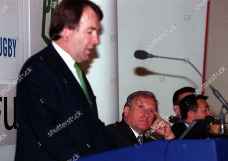 Gloucester Chairman Tom Walkinshaw represnting the chairman of the Premier League clubs listens to RFU Chielf Executive Francis Baron setting out the proposals of the RFU and Premier League clubs new agreement Twickenham 24/07/2001 Great Britain London