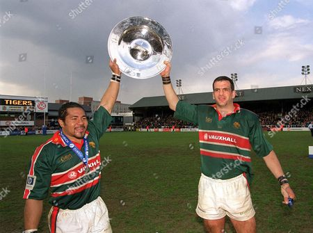 Freddie Tuilagi and Martin Johnson parade the Premiership Champions Plate at the end of the match Leicester Tigers v Newcastle Falcon The Premiership 13/4/02 Great Britain Leicester