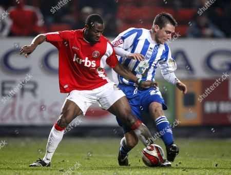Football Akpo Sodje of Charlton Athletic (on loan from Sheffield Wednesday) holds of Marcos Painterof Brighton and Hove Albion (on loan from Swansea City) Coca-Cola Division One Charlton Athletic v Brighton and Hove Albion at The Valley 23/02/2010