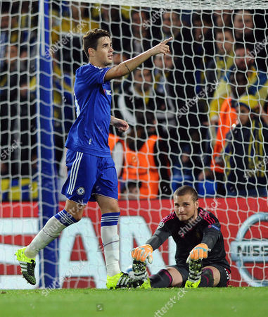 Football - 2015 / 2016 Champions League - Group G: Chelsea vs Maccabi Tel Aviv Oscar of Chelsea celebrates scoring goal 2 from the penalty spot with a dejected Predrag Rajkovic on the ground at Stamford Bridge