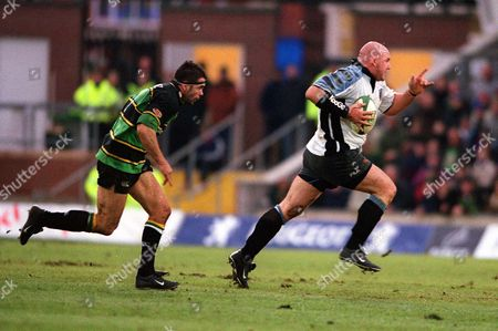 Craig Quinnell (Cardiff) is pursued by Budge Pountney (Northampton) Northampton v Cardiff The European Cup 12/1/02 Great Britain Northampton