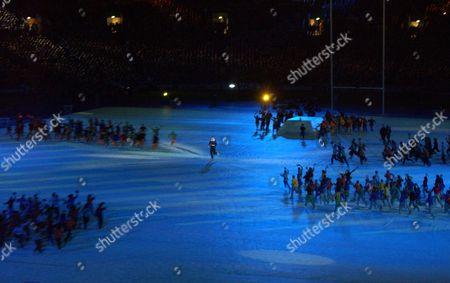 John Eales is surrounded by children Rugby World Cup Opening Ceremony Telstra Stadium Sydney 10/10/2003