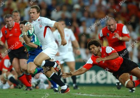 Mike Catt (England) gets away from Colin Charvis (Wales) England v Wales Rugby World Cup 1/4 Final Suncorp Stadium Brisbane 9/11/2003