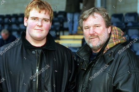 Stock Photo of Former Wales and British Lions player Derek Quinnell (right) with son Gavin who plays for Llanelli who were at the game to watch the Worcester debut of Craig Quinnell Worcester v Otley 18/01/2003 Great Britain Worcester