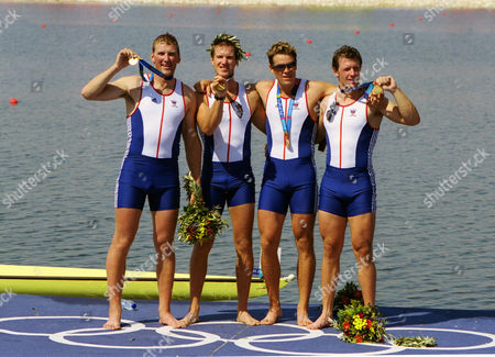 GBR Rowing Fours celebrate with their Gold Medals from left to right Matthew Pinsent Ed Coode James Cracknell and Steve Williams Rowing Athens Olympics 21/08/2004: