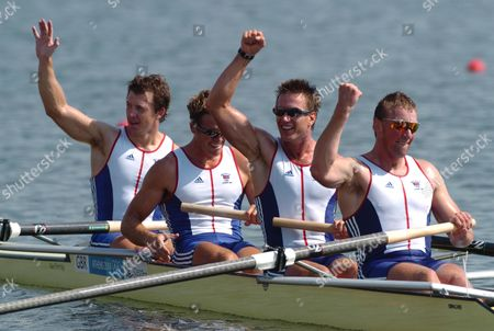 GBR's Gold Medal winning Coxless Four's (right to left) Matthew Pinsent Ed Coode James Cracknell and Steve Williams celebrate their victory Rowing Athens Olympics 21/08/2004