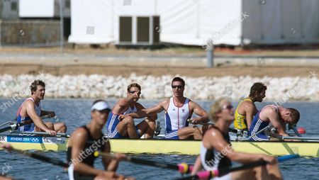 James Cracknell points the result of the photo finish on the scoreboard to teammate Ed Coode and GBR have won the Mens Fours Rowing Athens Olympics 21/08/2004: