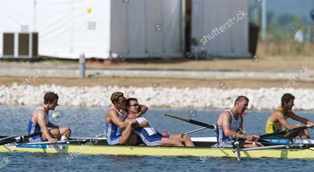 James Cracknell hugs Ed Coode as the GB team realise they have won the Rowing Fours Teammates Matthew Pinsent and Steve Williams sit exhausted at the front and back of the boat Athens Olympics 21/08/2004