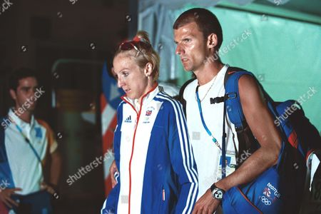 Paula Radcliffe (GBR) leaves the arena after receiving treatment for Dehydration with husband Gary Lough - her coach (pulling out of the race) Womens Marathon Final Athens Olympics 2004 21/8/2004