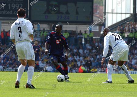 Ian Harte (L) and Michael Duberry (Leeds) try to stop Lomana Tresor LuaLua (Portsmouth) Leeds v Portsmouth Elland Road 25/04/2004 Premiership Football