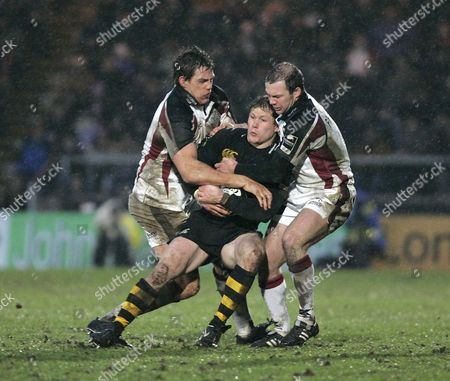 Josh Lewsey (Wasps) is tackled by Mike McCarthy and Ollie Phillips (Falcons) Wasps v Newcastle Falcons Rugby Union The Guinness Premiership The Causeway Stadium High Wycombe Bucks UK 08/01/2006 England High Wycombe