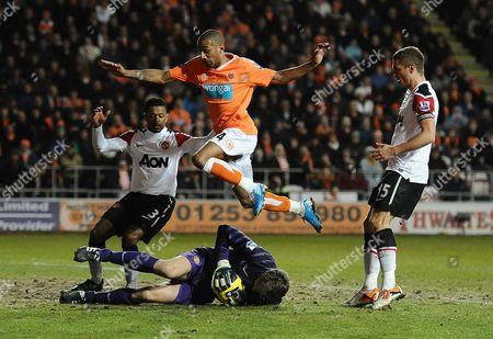 Football - Premier League - Blackpool vs Manchester United Edwin van der Sar of Manchester United save from an onrushing Elliot Grandin of Blackpool at Bloomfield Road Blackpool