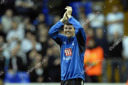 Football freestyler Billy Wingrove applauds the crowd after he sets a new world record for balancing the ball on his head whilst walking Tottenham Hotspur (Spurs) v Blackburn Rovers Barclays Premiership 28/10/07; White Hart Lane