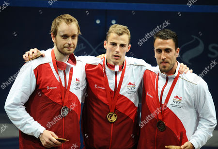 Squash - 2014 Glasgow Commonwealth Games - Day Five Men's Singles Medal Presentation England's medal winners left to right: James Willstrop (silver) Nick Matthew (gold) Peter Barker (bronze) at Scotstoun Sports Campus