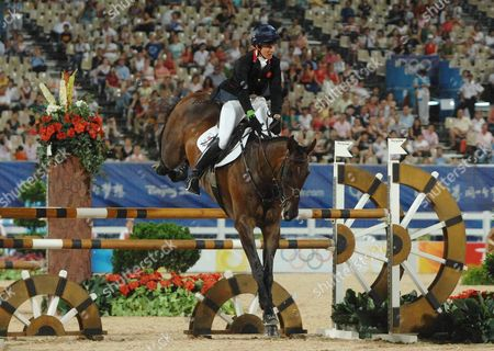 Stock Picture of Kristina Cook (Great Britain) on her way to her Bronze Medal Equestrian event Shatin Hong Kong Beijing Olympics 2008 12/8/2008 She is the daughter of Horse racing trainer Josh Gifford