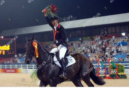 Stock Photo of Kristina Cook (Great Britian) celebrates her Individual Bronze Medal Equestrian event Shatin Hong Kong Beijing Olympics 2008 12/8/2008 She is the daughter of Horse racing trainer Josh Gifford