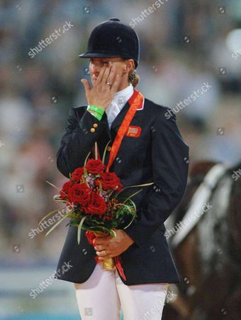 Medal Presentaion : Kristina Cook (Great Britain) wipes away a tear after celebrating her Bronze Medal Equestrian event Shatin Hong Kong Beijing Olympics 2008 12/8/2008 She is the daughter of Horse racing trainer Josh Gifford