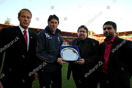 Darren Anderton receives a presentation from Paul Baker (Bournemouth Chairman) with Director Adam Merry (left) and Chief Executive Alastair Saverimutto (right) AFC Bournemouth vs Chester at Dean Court Bournemouth Coca-Cola Football League Two 6/12/2008 England London