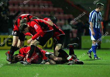Bournemouth team mates celebrate with Darren Anderton after he comes off the bench to score in his final game before retiring AFC Bournemouth vs Chester at Dean Court Bournemouth Coca-Cola Football League Two 6/12/2008 England London