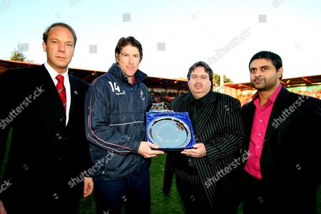 Darren Anderton receives his presentation from Paul Baker (Bournemouth Chairman) with Director Adam Merry (left) and Chief Executive Alastair Saverimutto (right) after announcing his retirement AFC Bournemouth vs Chester at Dean Court Bournemouth Coca-Cola Football League Two 6/12/2008 England London
